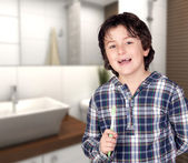 Smiling child without a toothbrush — Stock Photo