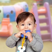 Adorable baby girl in the creche — Stock Photo