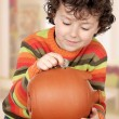 Stock Photo: Little boy with his big piggybank