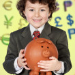 Adorable child with its savings in its money box of piggy — Stock Photo