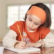 Stock Photo: Adorable girl studying