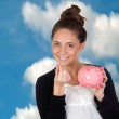 Attractive girl with money box — Stock Photo #19229729
