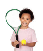 Happy latin child with a tennis racket — Stock Photo