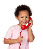 Latin child with red phone — Stock Photo