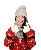 Attractive girl with wool hat and scarf saying Ok — Stock Photo
