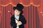 Adorable child dress of illusionist with hat — Stock Photo