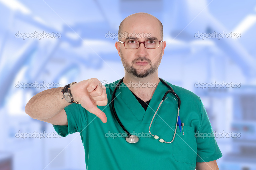 Serious medical with their thumbs down in the hospital — Stock Photo #19227865
