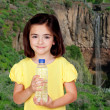 Brunette little girl with a water bottle  — Стоковая фотография