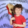 Young guitarist with guitar on his shoulder - Stock Photo