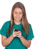 Teen girl writting a message by mobile — Stock Photo