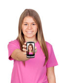 Teen with her ??picture on the mobile — Stock Photo