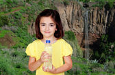 Brunette little girl with a water bottle — Stock Photo