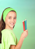 Adorable little girl with many colored pencils — Stock Photo