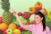 Young girl with fruits and vegetables — Stock Photo