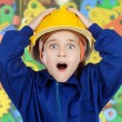 Surprised worker child - Stock Photo