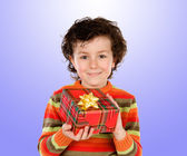 Beautiful child giving a present — Stock Photo