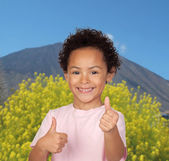 Happy latin child saying Ok with a volcano — Stock Photo