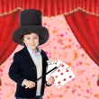 Foto Stock: Young magicidoing card trick