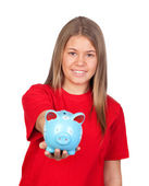 Teenager girl with a moneybox — Stock Photo