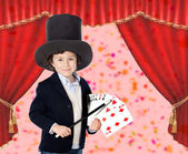 Young magician doing a card trick — Stock Photo