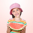 Adorable girl eating watermelon - Stok fotoğraf
