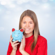 Teenager girl with a moneybox - Stock Photo