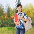 Teenager girl going to school - Stock Photo