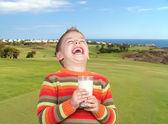 Happy child drinking milk — Stock Photo