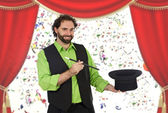 Happy magician with his barite — Stock Photo