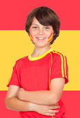 Spanish boy with t-shirt team and Spain flag — Stock Photo
