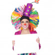 Funny girl clown with a blank advertising for text — Stock Photo