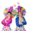 Couple of funny clowns with big colorful wigs — Stock Photo