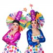 Couple of funny clowns with big colorful wigs — Foto de Stock