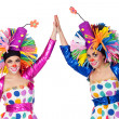 Stock Photo: Couple of funny clowns with hands joined