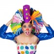 Surprised girl clown with a big colorful wig — Stock Photo