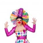 lustige Mädchen Clown mit einem großen bunten Perücke — Stockfoto