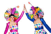 Paar lustige clowns mit händen trat — Stockfoto