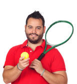 Bearded young men with tennis racket — Stockfoto