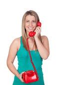 Attraente ragazza bruna chiamata con il telefono rosso — Foto Stock
