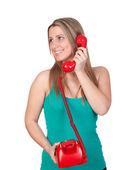 Attraktive brünette mädchen mit roten telefon aufrufen — Stockfoto