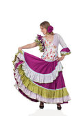 Spanish girl dressed in traditional costume Andalusian dancing — Stock Photo