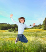 Adorable child jumping — Stock Photo
