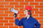 Industrial worker woman with a megaphone — Stock Photo