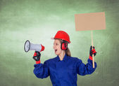 Industrial worker woman with a megaphone and a poster — Stock Photo
