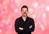 Young businessman with clown nose — Stock Photo