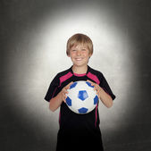 Preteen with a uniform for play soccer — Stock Photo