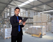 Young businessman with a clipboard — Stock Photo