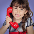 Beautiful girl talking on phone — Stock Photo