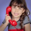 Beautiful girl talking on phone — Stock Photo