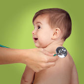 Adorable baby at the doctor's office for a pediatric examination — Stok fotoğraf